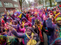 Indian people are dancing and throwing colored powders during the celebration of the Indian Holi Festival, in The Hague on March 21st, 2019. Millions of people around the world celebrate the annual Holi Hangámá Festival, also known as the Festival of Colours. For Hindus it's a celebration of the arrival of spring, the New Year and victory all in one. The largest Indian population in Europe (outside of the UK) can be found in The Hague, this is one of the largest in Europe. The highlight of the Holi celebrations is the procession through the multicultural Transvaal and Schilderswijk neighbourhoods. Participants in the procession throw brightly coloured powder on themselves and at each other to show that spring has begun. This year is also a very special celebration, they are also celebrating 145 years of the Hindustani immigration.(Photo by Romy Fernandez/Sipa USA)