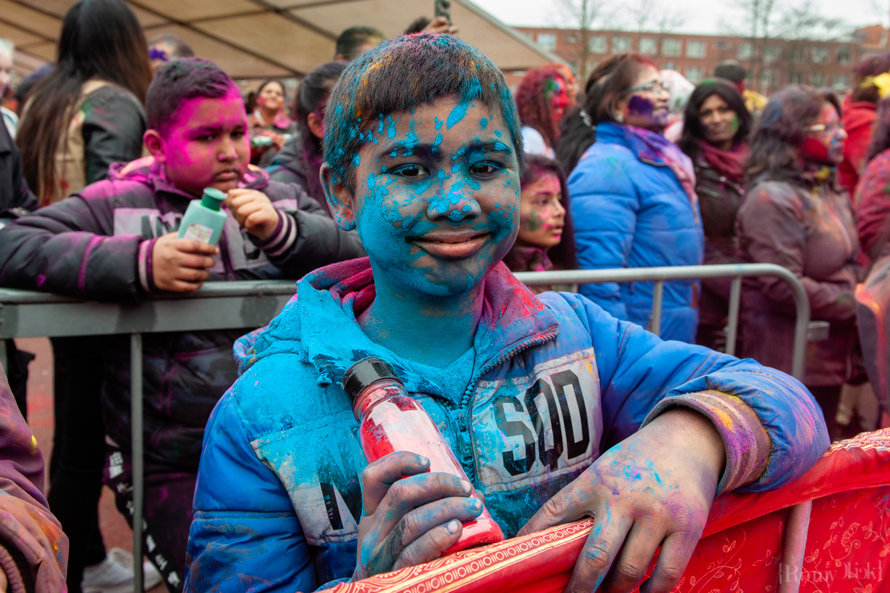 An Indian boy is covered with blue powder during the celebration of the Indian Holi Festival, in The Hague on March 21st, 2019.  Millions of people around the world celebrate the annual Holi Hangámá Festival, also known as the Festival of Colours. For Hindus it's a celebration of the arrival of spring, the New Year and victory all in one. The largest Indian population in Europe (outside of the UK) can be found in The Hague, this is one of the largest in Europe. The highlight of the Holi celebrations is the procession through the multicultural Transvaal and Schilderswijk neighbourhoods. Participants in the procession throw brightly coloured powder on themselves and at each other to show that spring has begun. This year is also a very special celebration, they are also celebrating 145 years of the Hindustani immigration.(Photo by Romy Fernandez/Sipa USA)
